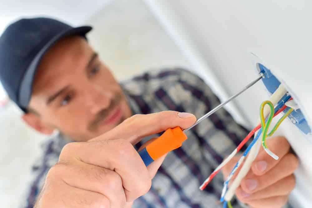 contractor repairing an electrical socket